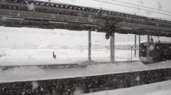 Snowfall at railway station Stock Footage