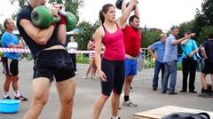 athletes lift weights - stock footage