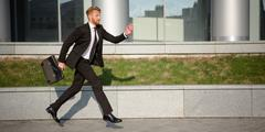 Businessman in hurry Stock Photos