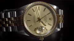 Extreme Close Up of Rolex Oyster Perpetual Date 18ct Gold watch. 4K UHD. Stock Footage