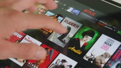 4K Netflix Movie Watching Selection on Tablet Stock Footage