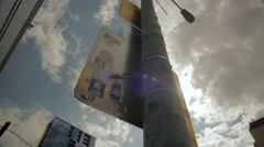 Sun Flares Around Light Pole and Sign Stock Footage