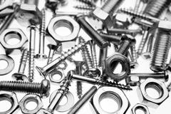 Assorted nuts and bolts closeup - stock photo