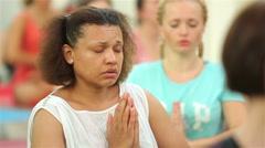 Yoga practice. Women meditate in namaste pose. Stock Footage