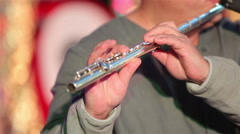 Flutist Plays The Flute. Close-up Stock Footage