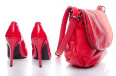 Red handbag and high heel shoes - stock photo