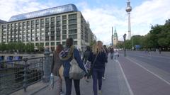 People walking on Karl-Liebknecht-Street in Berlin Stock Footage