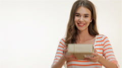 Young woman holding a present in hands Stock Footage