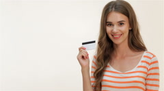Attractive girl showing thumbs-up with credit card Stock Footage