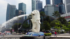 Zoom Out - Merlion Statue / Modern Singapore Skyline Stock Footage
