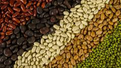 Mixture of dried lentils, peas, soybeans, beans background rotation 4k Stock Footage