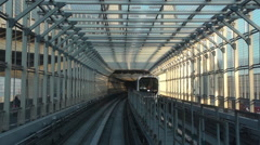 Yurikamome elevated automatic train journey Stock Footage