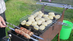 Kebab and potatos are fried on coals Stock Footage