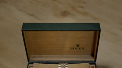 Rolex Oyster Perpetual Date, 18ct Gold watch, in box. 4K UHD. Stock Footage