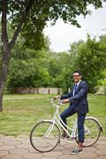 Cyclist in park - stock photo