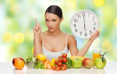 woman with healthy food and clock warning - stock photo