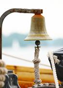 Bell on sailing ship - stock photo