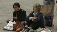 Girls sitting on the sidewalk, Berlin Stock Footage
