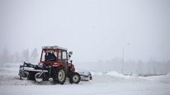 Automated snow plows are clearing a road during a snowstorm Stock Footage