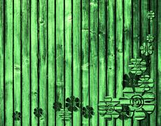 green wooden background with flowers - stock photo