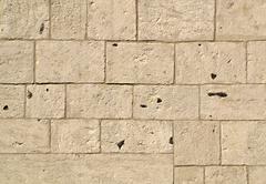 rectangular stone wall - stock photo