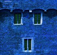 Stock Photo of red brick wall with windows