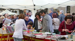 People looking books on street stalls Stock Footage