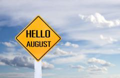 Hello August sign with sky background - stock photo