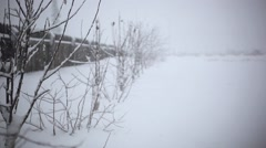 Stock Video Footage of Snowy trees and fence along winter road covered in thick snow during snowfall