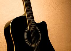 old acoustic guitar - stock photo