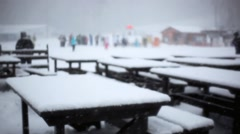 Chairs and table made from snow at Ski bar during snowfall in blizzard. Blurred Stock Footage