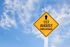 Word of 1ST AUGUST Switzerland on yellow sign - stock photo