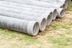 asbestos pipe for construction job - stock photo
