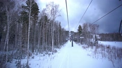 Ski track with chair lift, resort in mountains, Siberia - stock footage