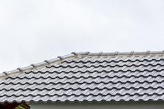 Roof under construction with stacks of roof tiles for home building Stock Photos