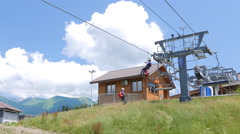 Stock Video Footage of Rescuers coach downhill lift. Sochi, Russia. 4K