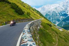 Alpine Road Biker. - stock photo