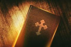Book of Christianity. Vintage Book in Glowing Light - stock photo