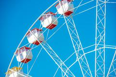 Ferris Wheel Closeup Over Clear Blue Sky. - stock photo