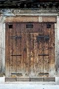Charming old wooden door house Stock Photos