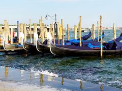 Gondola boats station floating Stock Photos