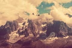 Mont Blanc Massif Scenery in Vintage Color Grading. Stock Photos