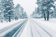 Winter Road Covered by Ice and Snow. Winter Weather Road Condition. - stock photo