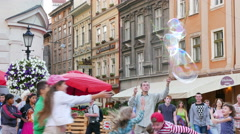 Street actors start up soap bubbles and children rejoice. 4K 3840x2160. Stock Footage