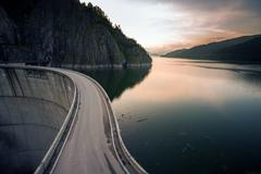 Artificial Lake behind the Bicaz Dam at sunset - stock photo