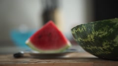 Cocomero, Boy eats watermelon slices red, anguria. Stock Footage