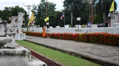 Novice cleaning foliage in morning time at Wat Phu Mintr Stock Footage