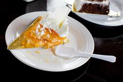 Half Eaten Slice of Orange Cake - stock photo