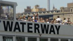 People traveling by NY Waterway in East River Lower Manhattan New York City NYC Stock Footage