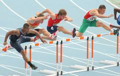Competitors of 110 meters hurdles - stock photo